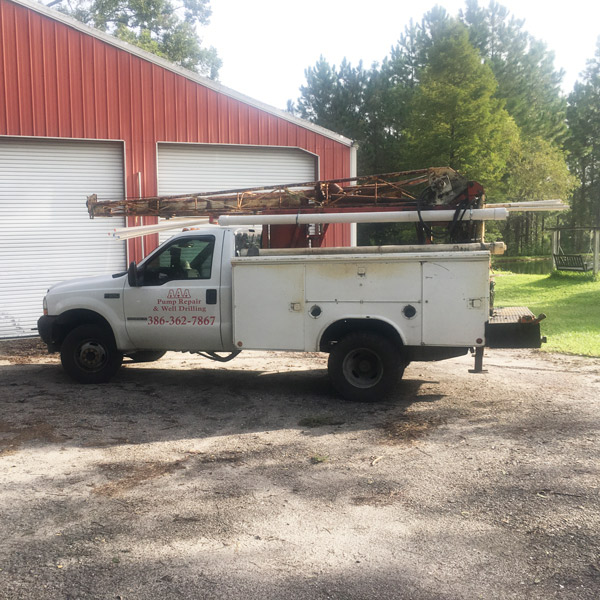 AAA Pump Repair & Well Drilling Truck